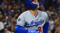 Los Angeles Dodgers outfielder Joc Pederson watches a home run