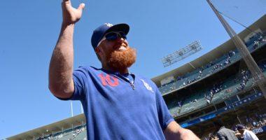 Los Angeles Dodgers third baseman Justin Turner waves to fans at Dodger Stadium
