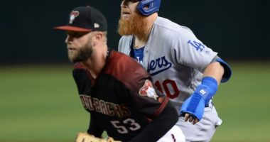Los Angeles Dodgers third baseman Justin Turner leads off from first base