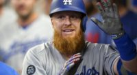 Los Angeles Dodgers third baseman Justin Turner is congratulated in the dugout after hitting a home run