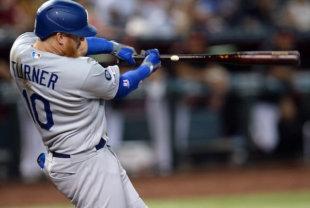 Los Angeles Dodgers third baseman Justin Turner hits a home run