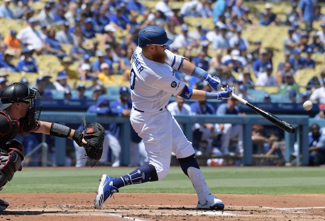 Los Angeles Dodgers third baseman Justin Turner hits a home run against the Arizona Diamondbacks