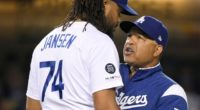 Los Angeles Dodgers manager Dave Roberts speaks with Kenley Jansen