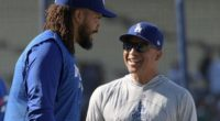 Los Angeles Dodgers manager Dave Roberts speaks with Kenley Jansen during batting practice at Dodger Stadium