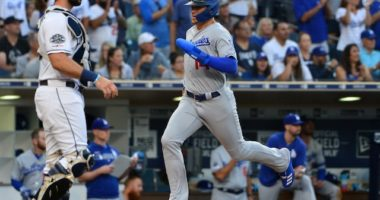 Los Angeles Dodgers utility player Kiké Hernandez scores a run against the San Diego Padres