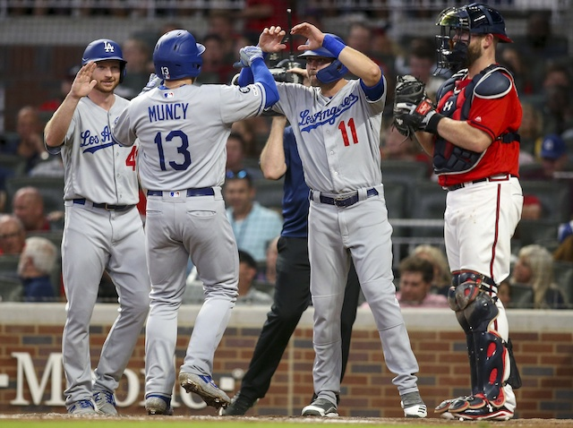 Los Angeles Dodgers teammates Kyle Garlick, Max Muncy and A.J. Pollock celebrate after a home run