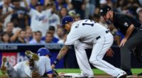 San Diego Padres third baseman Manny Machado attempts to tag out Los Angeles Dodgers catcher Will Smith