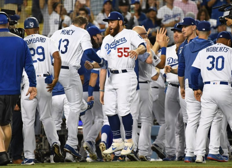 Matt Beaty, Bob Geren, George Lombard, Russell Martin, Max Muncy and Dave Roberts celebrate after a Los Angeles Dodgers walk-off win