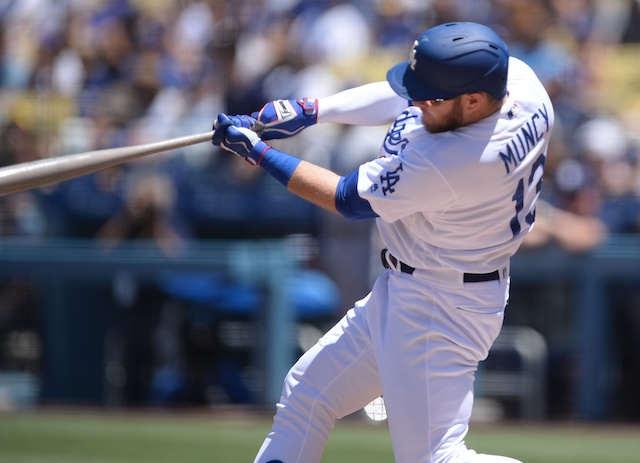 Los Angeles Dodgers infielder Max Muncy hits a home run against the San Diego Padres