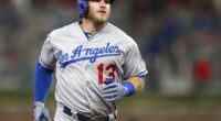 Los Angeles Dodgers infielder Max Muncy rounds the bases after hitting a home run