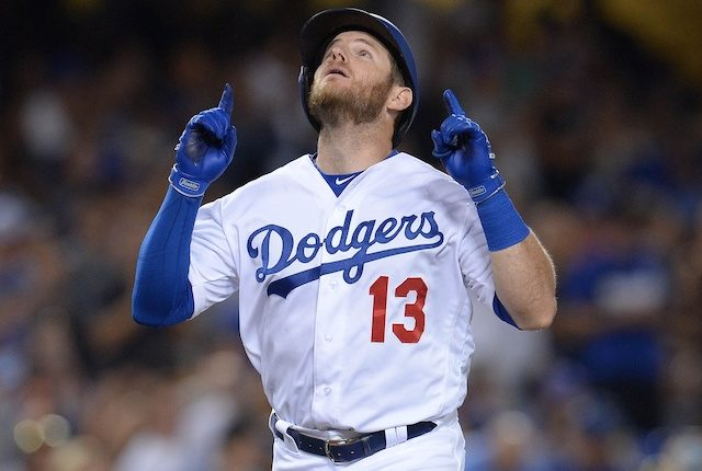 Los Angeles Dodgers infielder Max Muncy reacts after hitting a home run
