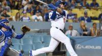 Los Angeles Dodgers infielder Max Muncy hits a home run