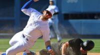 New York Yankees center fielder Brett Gardner slides into Los Angeles Dodgers second baseman Max Muncy