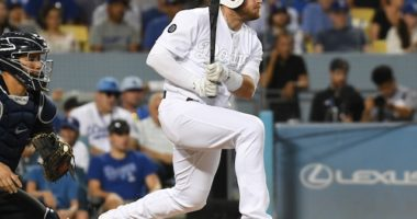 Los Angeles Dodgers infielder Max Muncy hits a single against the New York Yankees