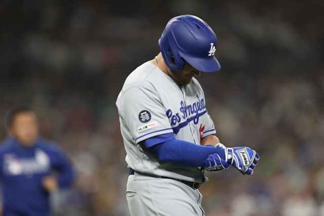 Los Angeles Dodgers infielder Max Muncy holds his right wrist after being hit by a pitch