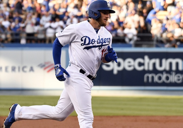Los Angeles Dodgers infielder Max Muncy rounds the bases after hitting a home run against the Arizona Diamondbacks