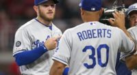 Los Angeles Dodgers manager Dave Roberts and Max Muncy celebrate after a win