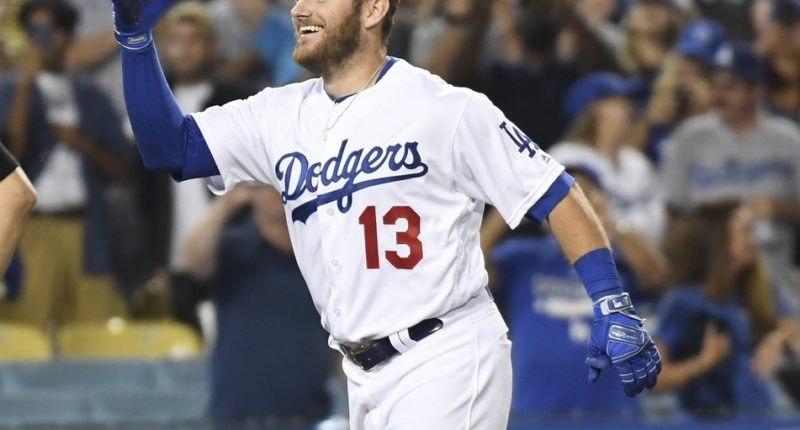 Los Angeles Dodgers infielder Max Muncy celebrates after hitting a walk-off home run