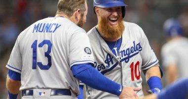 Los Angeles Dodgers teammates Max Muncy and Justin Turner celebrate after hitting back-to-back home runs