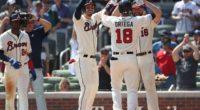 Atlanta Braves teammates celebrate after Rafael Ortega's grand slam against the Los Angeles Dodgers