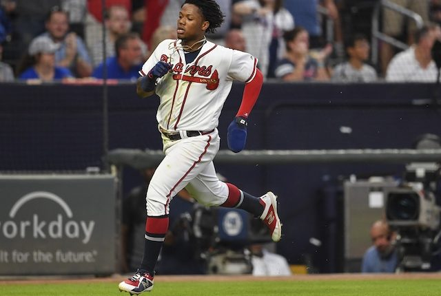 Atlanta Braves outfielder Ronald Acuña Jr. scores a run against the Los Angeles Dodgers