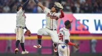 Atlanta Braves teammates Ronald Acuña Jr., Ozzie Albies and Adeiny Hechavarría celebrate after a win against the Los Angeles Dodgers