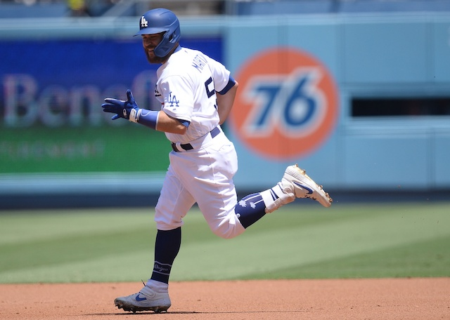Los Angeles Dodgers catcher Russell Martin rounds the bases after hitting a home run