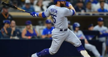 Los Angeles Dodgers catcher Russell Martin drives in a run against the San Diego Padres