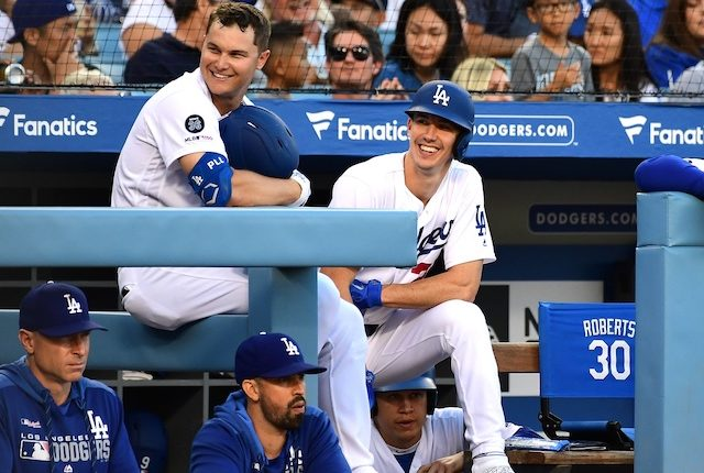 Los Angeles Dodgers hitting coach Robert Van Scoyoc, hitting assistant Brant Brown, Walker Buehler and Joc Pederson in the dugout at Dodger Stadium