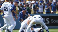 Walker Buehler, Kiké Hernandez, Russell Martin, Joc Pederson and Casey Sadler celebrate after a Los Angeles Dodgers walk-off win