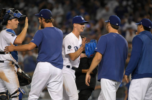 Walker Buehler, Rich Hill, Clayton Kershaw, Hyun-Jin Ryu and Will Smith celebrate after a Los Angeles Dodgers win