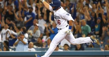 Los Angeles Dodgers catcher Will Smith reacts after hitting a grand slam against the San Diego Padres