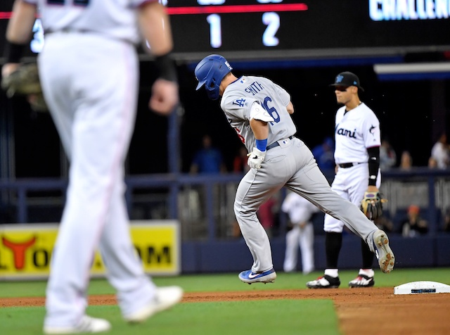 Los Angeles Dodgers catcher Will Smith rounds the bases after hitting a home run against the Miami Marlins