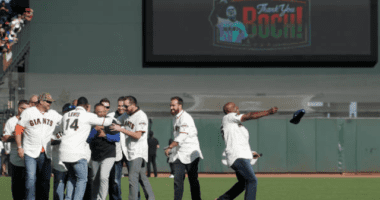 Former San Francisco Giants players greet Los Angeles Dodgers manager Dave Roberts during the Bruce Bochy ceremony
