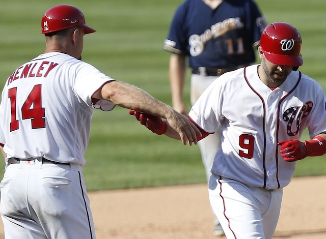 Washington Nationals second baseman Brian Dozier rounds the bases after hitting a home run against the Milwaukee Brewers