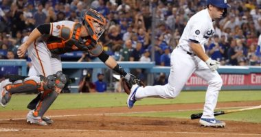 San Francisco Giants catcher Buster Posey attempts to tag Los Angeles Dodgers catcher Will Smith on a strikeout