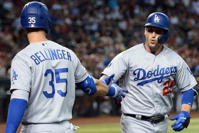 Los Angeles Dodgers teammates Cody Bellinger and David Freese celebrate after a home run