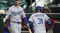 Los Angeles Dodgers teammates Cody Bellinger and Joc Pederson celebrate after a home run