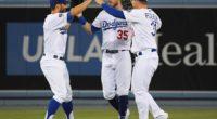 Cody Bellinger, Joc Pederson and Chris Taylor celebrate after a Los Angeles Dodgers win