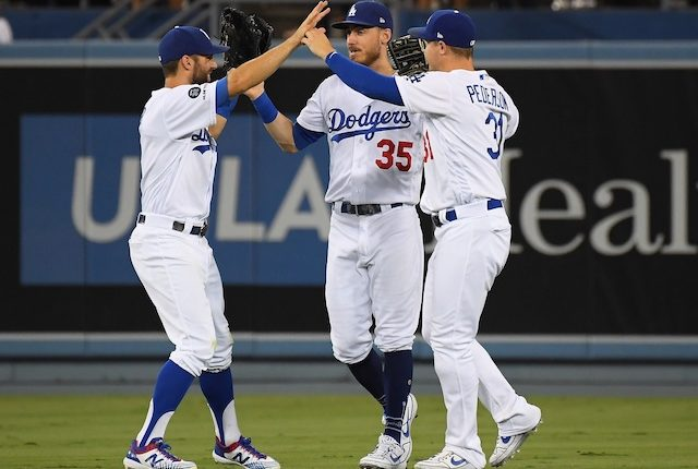 Cody Bellinger, Joc Pederson and Chris Taylor celebrate after a Los Angeles Dodgers win