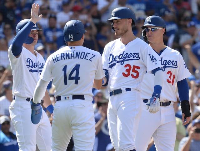 Los Angeles Dodgers teammates Cody Bellinger, Kiké Hernandez, Gavin Lux and Joc Pederson celebrate after a grand slam