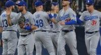 Los Angeles Dodgers teammates Cody Bellinger, Kiké Hernandez, Gavin Lux, Max Muncy, Joc Pederson and Chris Taylor celebrate after a win against the San Diego Padres