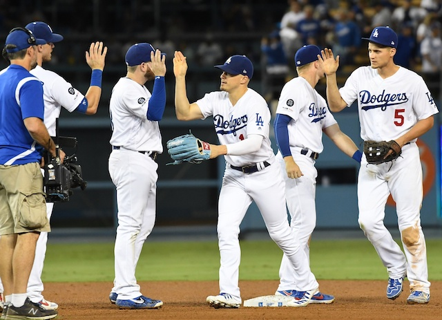 Los Angeles Dodgers teammates Cody Bellinger, Kiké Hernandez, Gavin Lux, Max Muncy and Corey Seager celebrate after a win