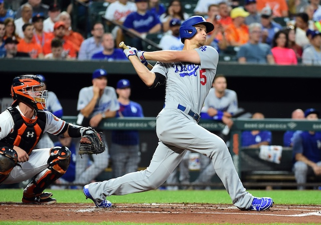 Los Angeles Dodgers shortstop Corey Seager hits a home run against the Baltimore Orioles