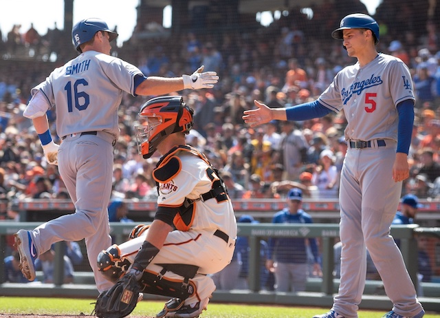 Los Angeles Dodgers teammates Corey Seager and Will Smith celebrate after a home run