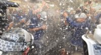 Manager Dave Roberts and the Los Angeles Dodges celebrate after clinching the NL West