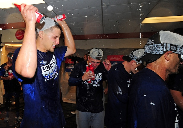 Dino Ebel, Gavin Lux, Corey Seager and the Los Angeles Dodgers celebrate after clinching the NL West during the 2019 season