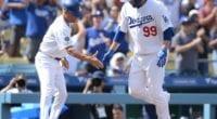 Los Angeles Dodgers third base coach Dino Ebel congratulates Hyun-Jin Ryu after his home run