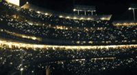 Fans hold up their cellphones during a concert at Dodger Stadium