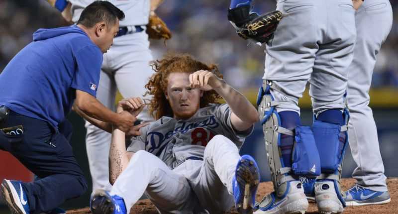 Los Angeles Dodgers trainer helps Dustin May after he was hit in the head by a line drive